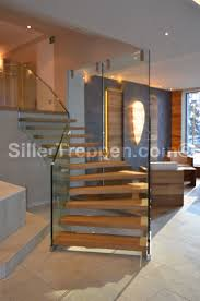 floating stairs, structural glass stairs, commercial stairs, hotel stairs,  custom design stairs