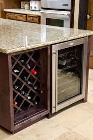 jenn air wine cooler with built in wine rack located in the kitchens