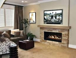 hanging tv above fireplace stone