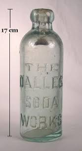hutchinson soda bottle with heavy embossing to enlarge