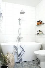 tubs for small bathrooms a very small bathroom with a patterned grey tile floor and a