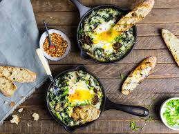 baked eggs with creamy greens mushrooms and cheese recipe