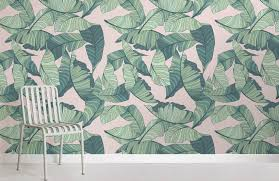 pink and green tropical leaf design room wall