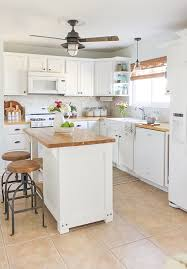 10 fab farmhouse kitchen makeovers where they painted the existing cabinets the happy housie