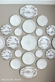 I love how the plate wall draws your eye across the dining room as you look  into it from the foyer: Hanging plates to create a decorative ...