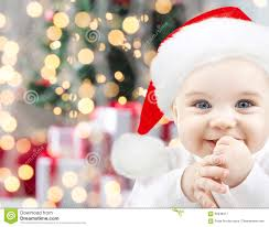 Baby Pics With Christmas Lights Happy Baby In Santa Hat Over Christmas Lights Stock Image
