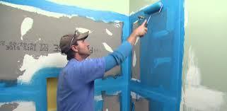 applying waterproofer to cement backer board before tiling applying a waterproofing sealer