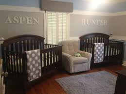 nursery room for twin boywith black wooden baby crib and gray white polkadot bedding set combined biege study twin kids study room
