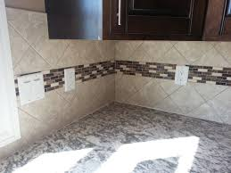 4X4 Decorative Tiles 100x100 Tile backsplash set at an diagonal with an accent stripe going 86