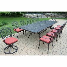 oakland living berkley 13 piece outdoor patio set with extendable table 10 chairs 2 swivel rockers and cushions