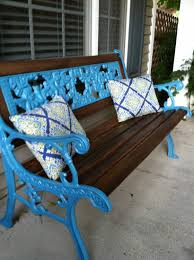 spruce up a wrought iron bench with some dark stain and a bright coat of spray paint