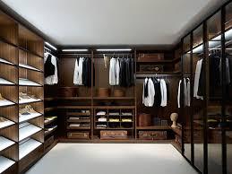 Lifetime Luxury - Luxury Closet Ideas051 - inside a dark wallnut wooden  closet. White floor