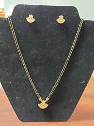 22k black bead yellow gold necklace