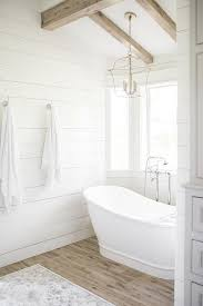 cottage bathtub alcove with plank walls