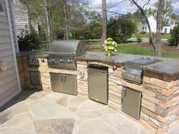 patio outdoor stone kitchen bar:  kitchen astounding not bad house with img zp along with custom outdoor kitchen island