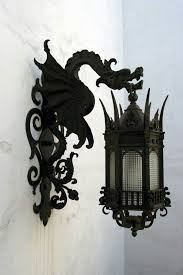 black wrought iron dragon lanterns for either indoor outdoor lighting