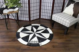 black white patchwork rug rodeo cowhide rugs layered living room caramel chocolate brown