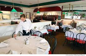 waitress erika hernandez sets tables in the dining room ristorante duo rose an