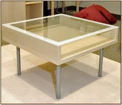 nice glass coffee table with storage