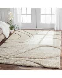 beige and white area rug