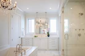 interior all white master bathroom with chandelier over tub transitional top bathrooms fresh 0