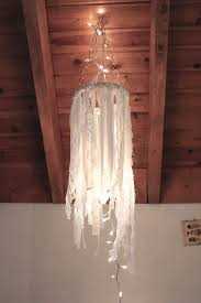 diy white lights shab chic chandelier tutorial from boat people make shabby chic chandelier