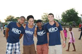 HERO CONDOMS founder Dustin Leonard with some of the youth he works with in  Botswana -