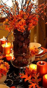 Leaves and orange candles make for the perfect intimate #Thanksgiving table  setting. Fall Table CenterpiecesFall ...