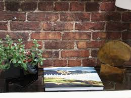 classic interior house wall decor with exposed brick wall feat wooden table also green plant as eco friendly home ideas