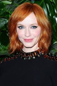 christina hendricks is officially giving us red hair goals her soft wavey bob and fiery colour stood out at an event in la