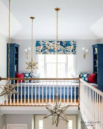 staggered glass and brass moravian star staircase pendant lights add a charming addition to the blue themed decor