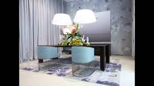 blue modern dining chairs with arm and dark brwon square dining table on blue fl