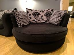 nearly new dfs 3 seater black and grey sofa and swivel chair