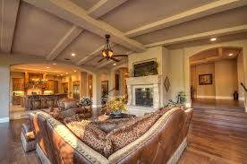 Vaulted Ceiling Living Room In Open Space Shared With Large White Fireplace Under Vaulted