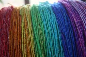 this yarn has its colours in long sections so as i pulled the yarn off the skein i wrapped it into equal lengths this is pretty easy to do by wrapping