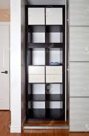 bookcases built in closet with sliding door shelving storage organization altra aaron lane bookcase with sliding