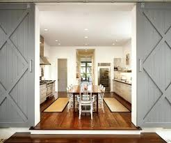 grey painted sliding barn doors over glass cool interior