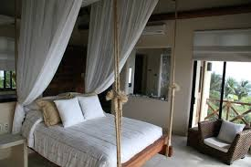 Sweeping canopy netting softens the rope, highlighting the romantic look of  this bedroom. Source