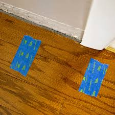 blue painter s tape on a new floating floor