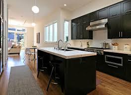 kitchen grey floor tile white marble hanging lamp light countertop black backsplash kitchen cabinet with