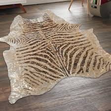 metallic splashed zebra cowhide rug 2 colors shades of metallic gold bathroom rugs