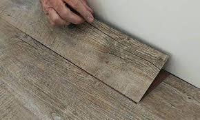vinyl over tile vinyl floating floor vinyl plank floating floor over tile in kitchen how to vinyl over tile