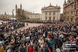 """A Cambridge Diary on Twitter: """"A wonderful turn out for Stephen Hawking's  funeral today @GreatStMarys. Many thanks to @CUPBookshop for allowing me to  hang out of their window.… https://t.co/5Ddtay8lhq"""""""