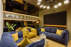 azure blue and bright yellow sofa set in entertainment area