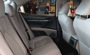 our 6 tester demonstrates how easy it is to access the camry s spacious back seat it also shows how much kneeroom there is when the driver s seat is