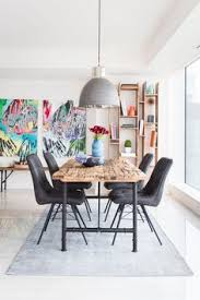 the timber dining table works so well with the various bright colors that surounding