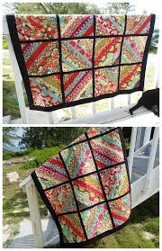 My serger jelly roll quilt is finished - So Sew Easy & Quick and simple jelly roll quilt, made with a single jelly roll plus a  solid Adamdwight.com