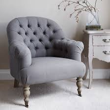 small occasional on back armchair with a curved back and wooden turned legs upholstered in a
