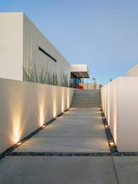 lighting on wall. Exterior: Classy Lighting On Cute Gravel Closed White Color Wall Plus Nice Stapping And Interesting N