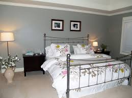 white comfortable bedding sheet white floor lamp basement bedroom ideas black fur rugs on grey carpet floors bedside light wood table white covered bedding basement bedroom lighting ideas